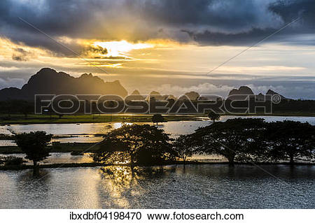 Stock Photography of Sunset above tower karst mountains.