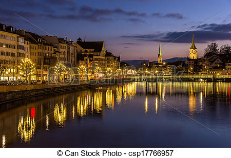 Stock Images of Zurich on banks of Limmat river at winter evening.
