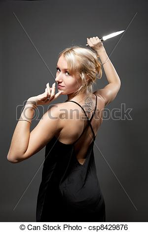 Stock Image of Beauty woman in evening dress with ritual knife.