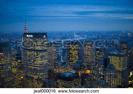 Stock Images of USA, New York, Manhattan, view to lighted skyline.