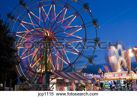 Stock Image of Evergreen State Fair at twilight with Ferris Wheel.