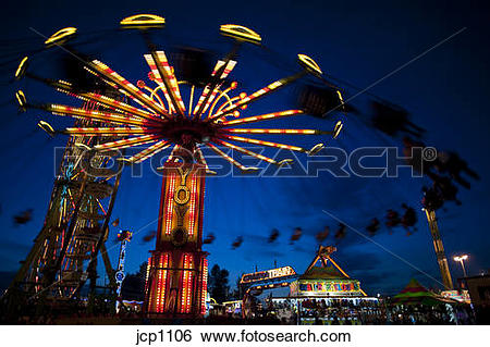 Stock Images of Rides at twilight at the Evergreen State Fair.