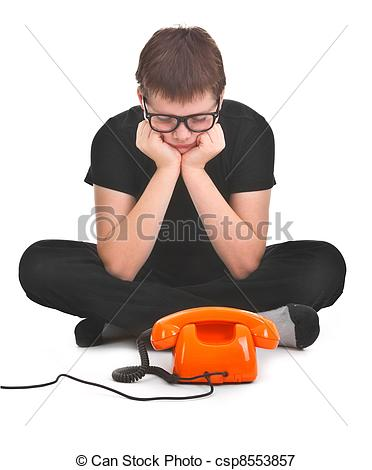 Picture of sad boy is waiting for expected phonecall over white.