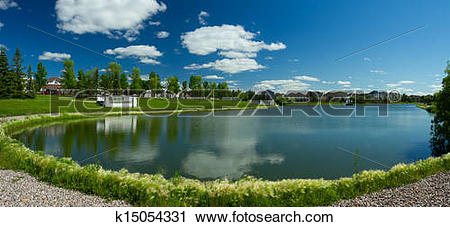 Stock Photography of Beautiful pond in expensive neighborhood.