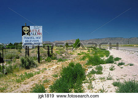Stock Photograph of Home made sign along the Extraterrestrial.