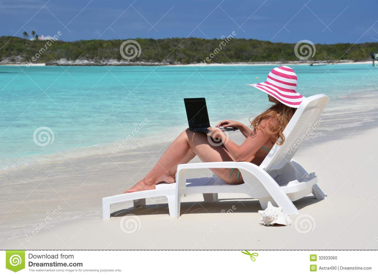 Girl On The Beach Of Exuma, Bahamas Stock Photo.