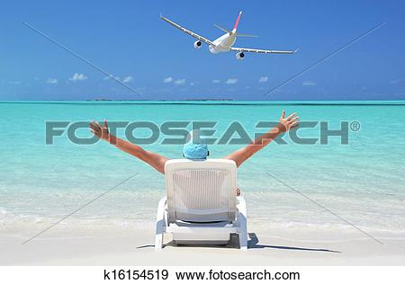 Stock Photograph of A man sunbathing on the beach of Great Exuma.