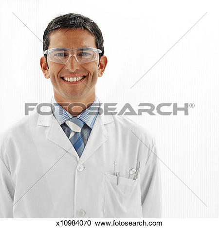 Stock Photography of portrait of a male dentist wearing protective.
