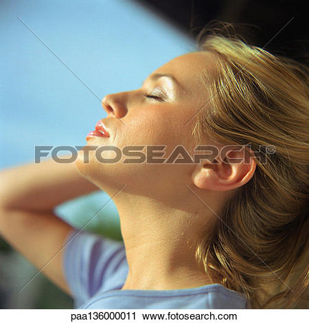 Stock Photography of Profile of woman with head back and eyes shut.