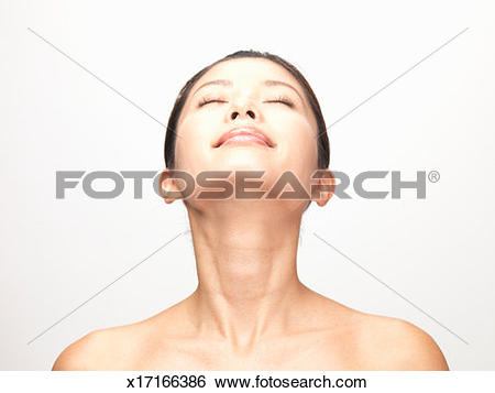 Stock Images of Woman with closed eyes tilting head back, studio.