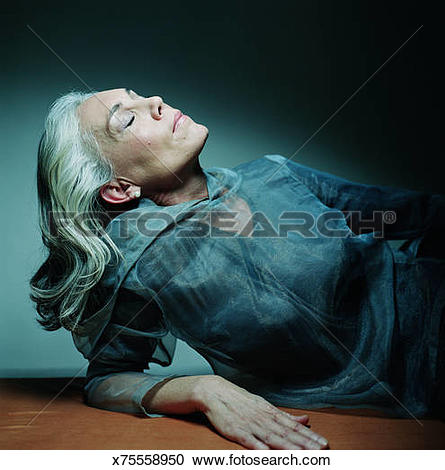 Stock Photography of Mature woman, head thrown back, eyes closed.