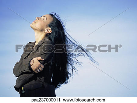 Stock Photography of Young woman, head back, eyes close, side view.