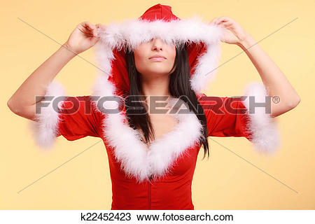 Stock Photo of woman wearing santa claus costume covering her eyes.