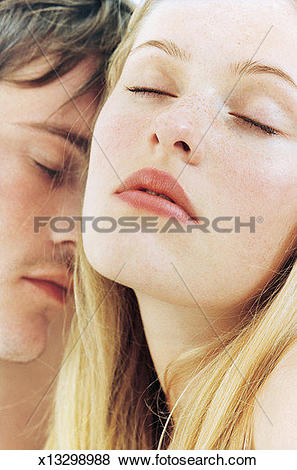 Pictures of Intimate young couple, eyes closed, close.