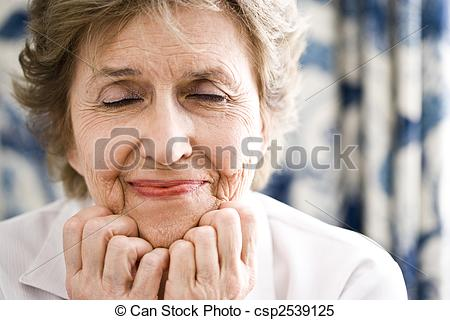 Stock Images of Closeup of elderly woman with her eyes closed.