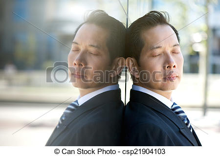 Stock Photography of Businessman thinking with eyes closed.