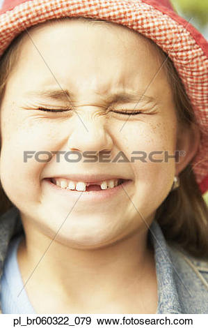 Stock Photograph of Close up of Hispanic girl smiling with eyes.
