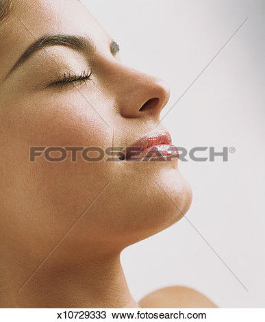 Stock Photo of Young woman with eyes closed, profile, close.