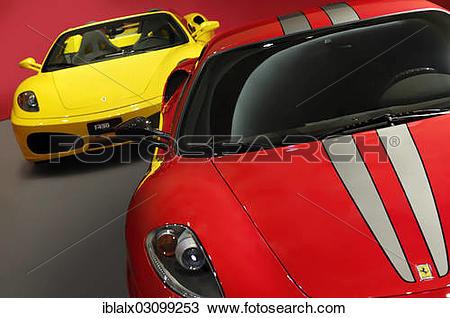 "Stock Photo of ""Ferrari F430 Scuderia red and yellow, supercars."