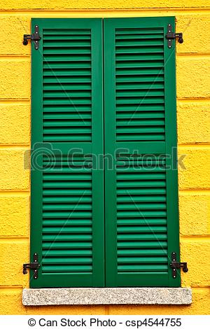 Stock Illustrations of Closed green window shutters on yellow.