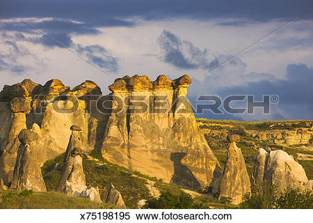 Stock Image of Fairy chimney rock formation in Goreme at sunset.