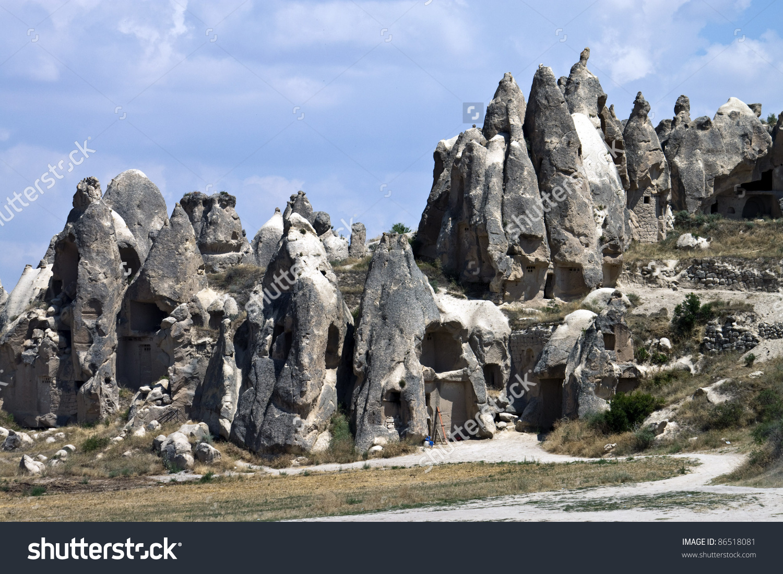 Cave Houses (Fairy Chimneys) In Cappadocia, Turkey Stock Photo.
