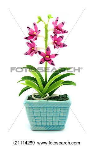 Stock Photograph of Purple fake flowers in the vase k21114259.