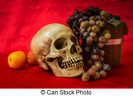 Stock Photo of Still life with a human skull with fake apples and.