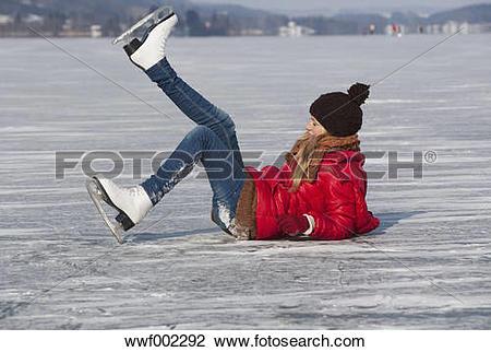 Stock Photo of Austria, Teenage girl fallen on ice rink while.