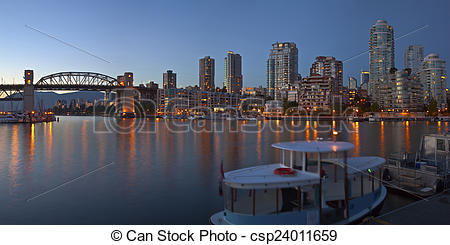 Stock Images of Vancouver BC skyline at False Creek at dusk.