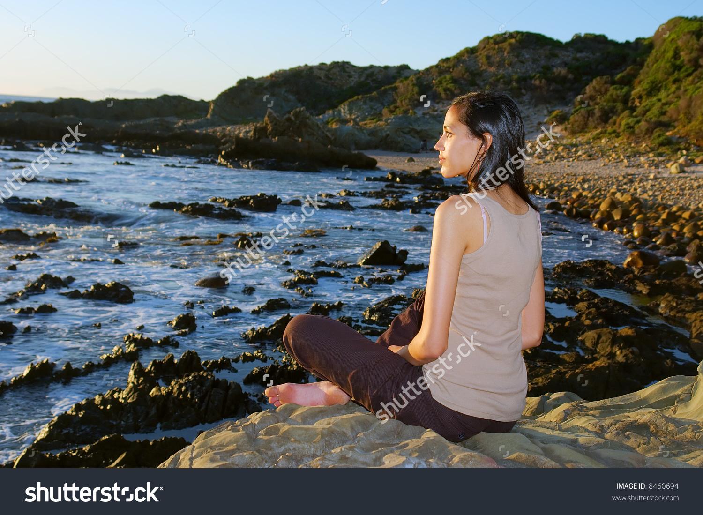 Meditating Colored Girl On Sea Shore.