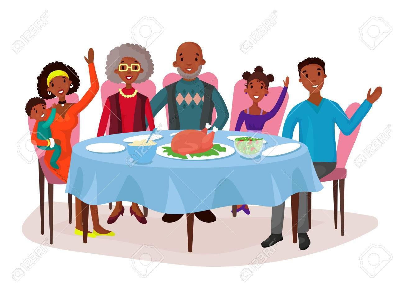 Happy afro american family at dinner table.