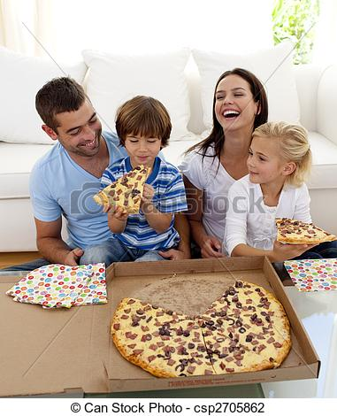 Stock Photo of Smiling family eating pizza in living.