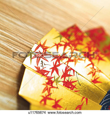 Stock Photo of Japanese folding fan painted maple leaves in.