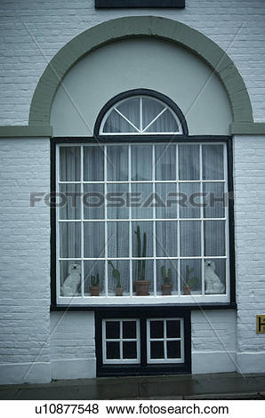 Pictures of Arched fanlight above traditional townhouse window.