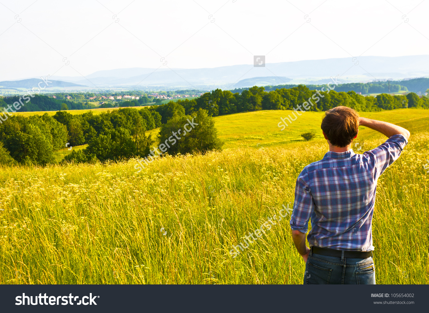 Man Looking Far Away Standing On Stock Photo 105654002.