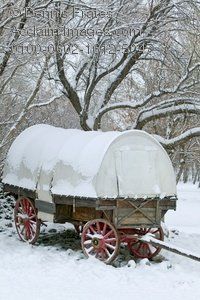 Stock Photo of Covered Wagon in The Winter Snow.