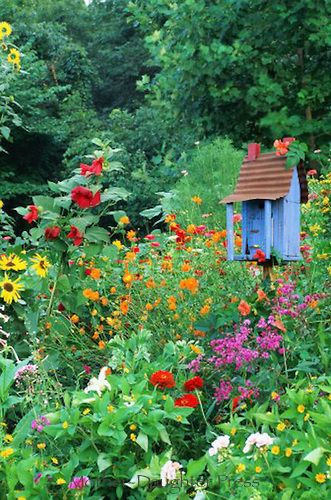Handmade birdhouse in flower garden // Swede Cottage Farm <3 this.