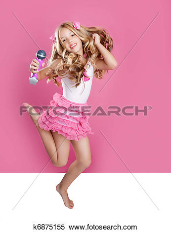 Stock Image of children little star singer like fashion doll with.