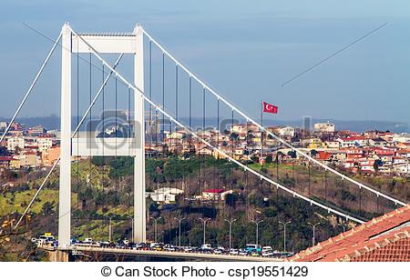 Stock Photo of The Fatih Sultan Mehmet Bridge With Turkish Flag.