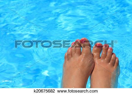 Stock Photo of Wet female feet inside water k20675682.
