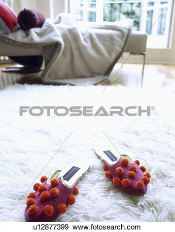 Stock Photograph of Red and purple felt slippers on flufffy white.