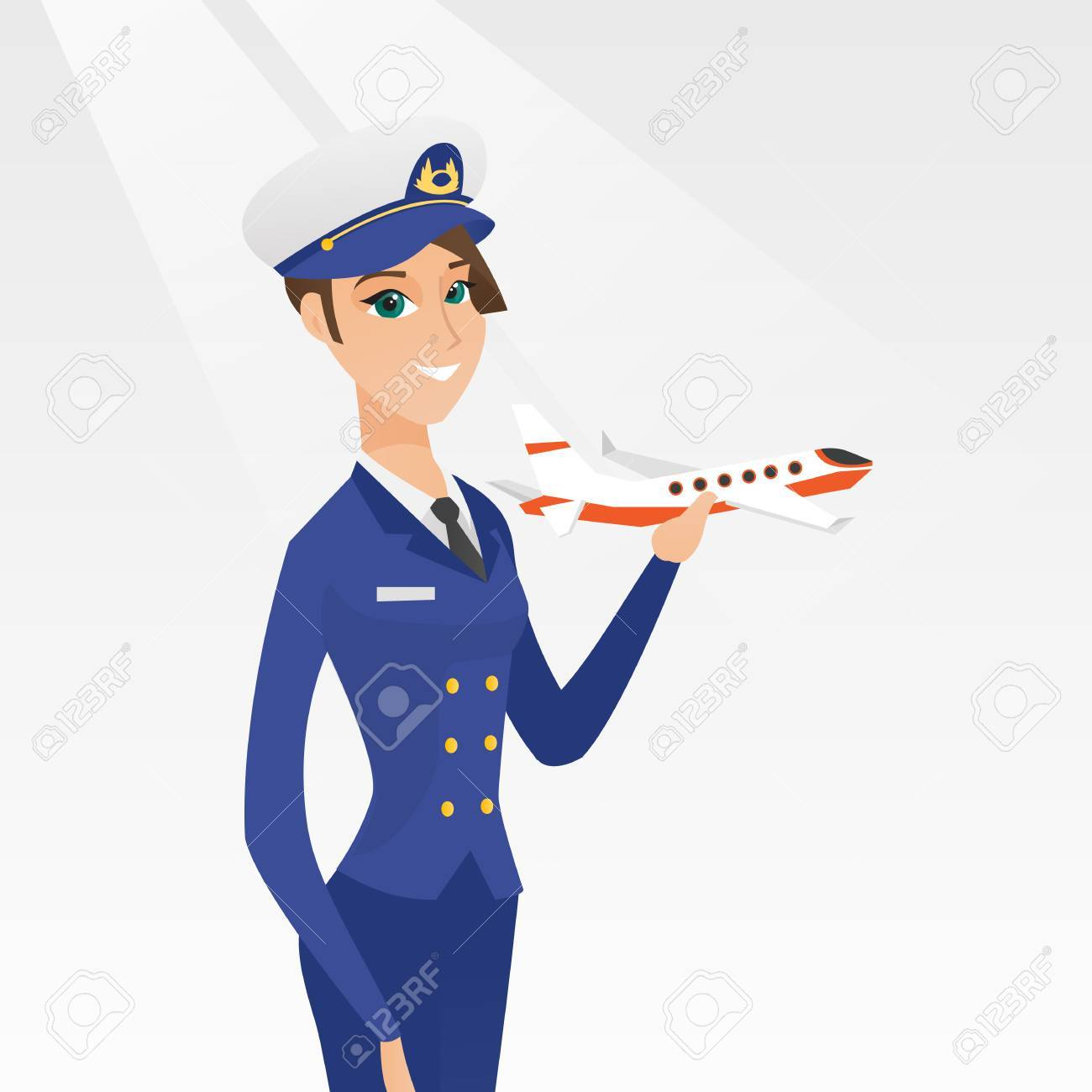 Young caucasian airline pilot holding the model of airplane in...