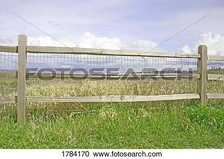 Stock Photography of Post and rail fence along a meadow 1784170.
