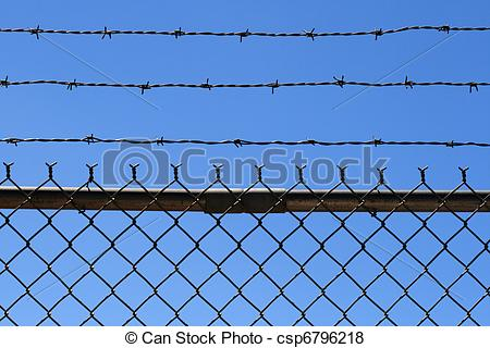 Pictures of barbed wire fence top.