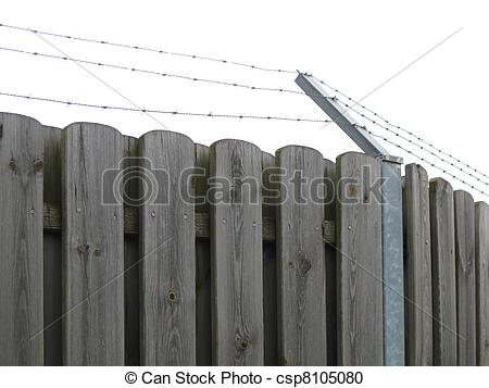 Stock Photography of Wooden fence with barbed wire on top.