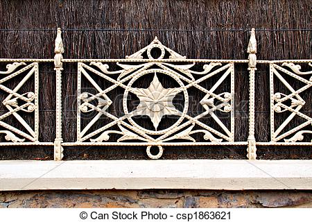 Stock Photography of Decorative Metal Fencing, on top of stone.
