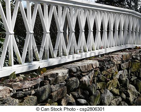 Stock Photography of fence and stone.