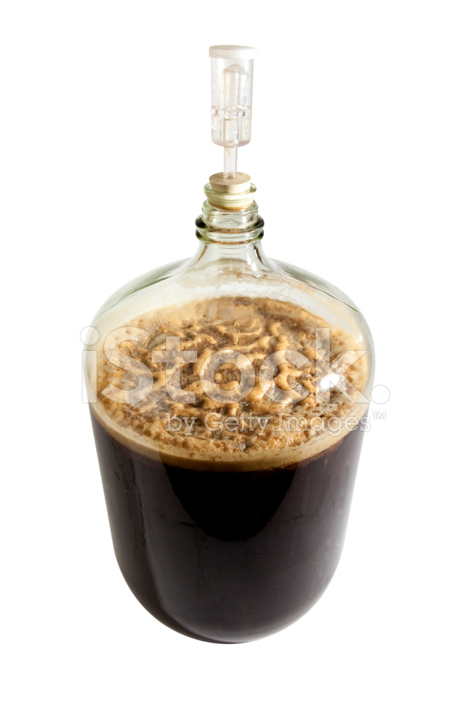 Carboy Full of Brewing Beer With Clipping Path stock photos.