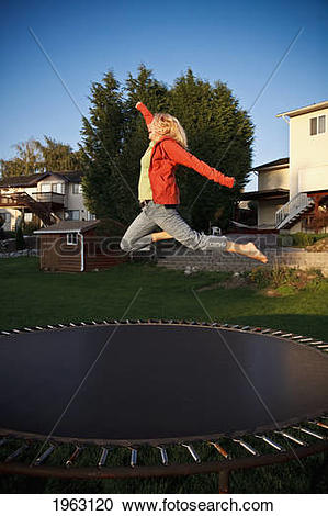 Stock Photography of woman jumps on a trampoline; ferndale.